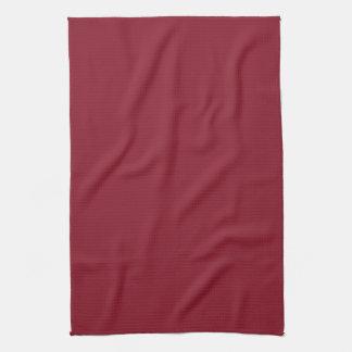 Fondo sólido rojo oscuro del color de la tendencia toalla de cocina