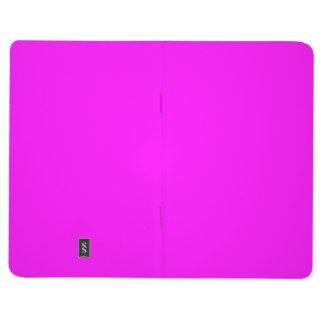 Fondo sólido rosado magenta fucsia del color de la cuaderno grapado