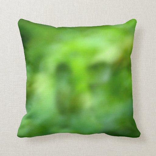 fondo verde abigarrado cojines