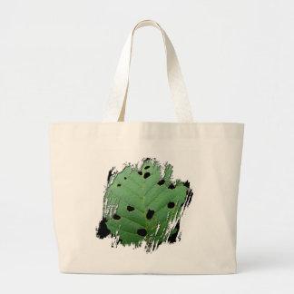 Fondo verde del negro de la hoja bolsas lienzo