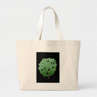 Fondo verde del negro de la hoja bolsa lienzo