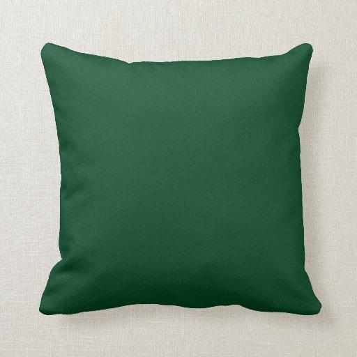 Fondo verde imperecedero en una almohada cojín decorativo