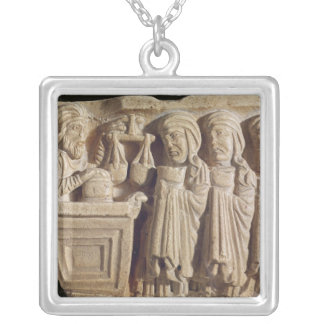 Font depicting an unguent seller silver plated necklace