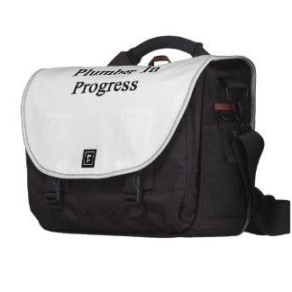 Fontanero en curso bolsas de ordenador
