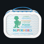 """Food Allergy Alert Superhero Boys Lunchbox<br><div class=""""desc"""">Label reading, epinephrine carrying food allergy super hero. Remind others at meal times of food allergies. Great for kids with food allergies to store safe snacks at school or carry epinephrine inside. Green Silhouette of superhero boy on blue chevron stripe background. Multi-colored text. Personalize with name. Designs by Lil Allergy...</div>"""