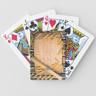 Food background with thin spaghetti and pasta bicycle playing cards