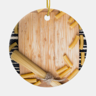 Food background with thin spaghetti and pasta ceramic ornament