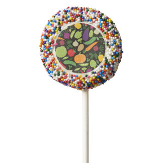 Food on a black background chocolate dipped oreo pop