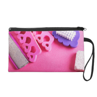 Foot care wristlet purse