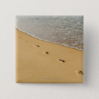 Foot prints in Sand with Wave Button