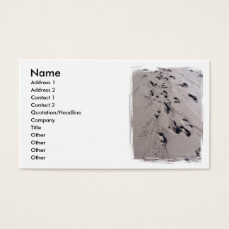 Foot prints in wet beach sand towards viewer business card