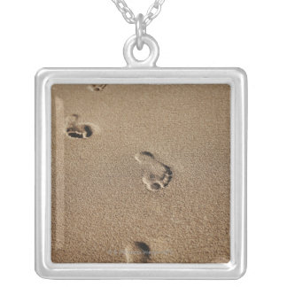 Foot steps in sand square pendant necklace