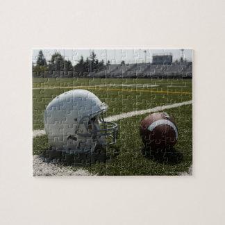Football and football helmet on football field jigsaw puzzle
