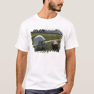 Football and football helmet on football field T-Shirt