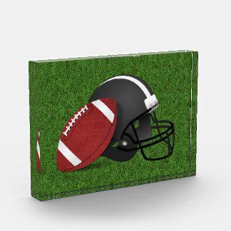 Football and Helmet on Grass Award