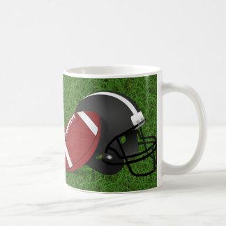 Football and Helmet on Grass Mug