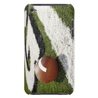 Football at goal line on football field iPod touch case