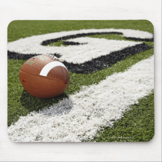 Football at goal line on football field, mouse pad
