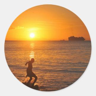 Football at sunset classic round sticker