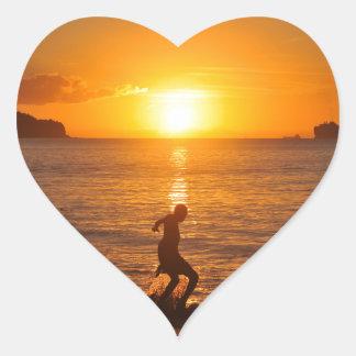 Football at sunset heart sticker