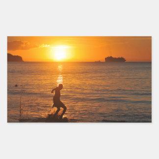 Football at sunset rectangular sticker