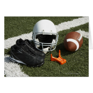 Football, football helmet, tee and shoes on greeting cards