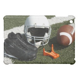 Football, football helmet, tee and shoes on iPad mini cover