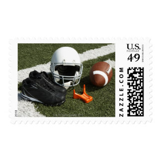 Football, football helmet, tee and shoes on stamps