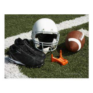 Football, football helmet, tee and shoes on postcard