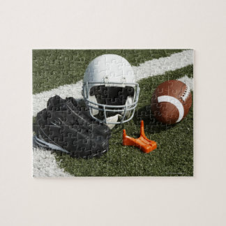 Football, football helmet, tee and shoes on jigsaw puzzle