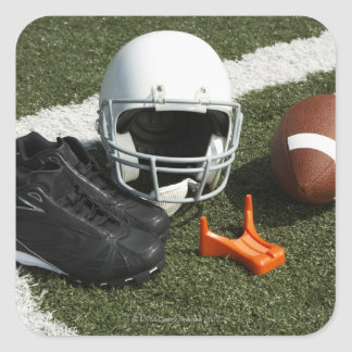 Football, football helmet, tee and shoes on square sticker