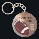 "Football Keychain<br><div class=""desc"">Personalize this customizable football keyring with your own name or text.  Click &quot;Customize It&quot; to modify the design further.</div>"