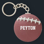 "Football Laces Personalized Keychain<br><div class=""desc"">Show your love for the gridiron game with this keychain featuring football texture and fully personalized with ANY name,  team or nickname (Superstar,  Hero,  Gipper,  etc.)</div>"