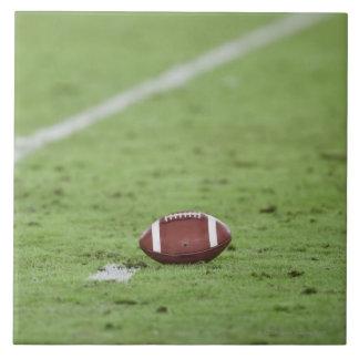 Football near yardage line. ceramic tile