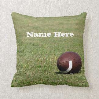 Football on Field Throw Pillows