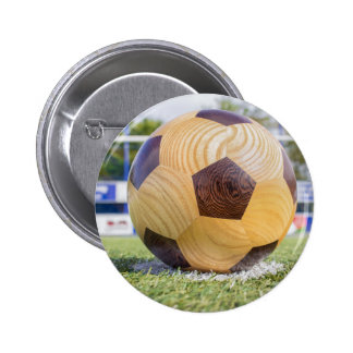 football on penalty spot with goal button