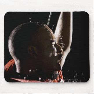 Football player cooling off with water mouse pad