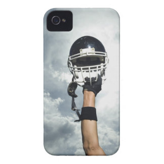 Football player holding helmet in air iPhone 4 cover