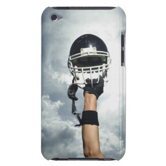 Football player holding helmet in air iPod touch case