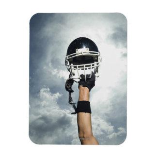 Football player holding helmet in air rectangular photo magnet