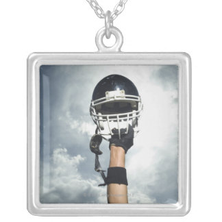 Football player holding helmet in air silver plated necklace