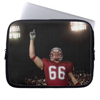 Football player holding up index finger laptop sleeve