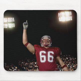 Football player holding up index finger mouse pad