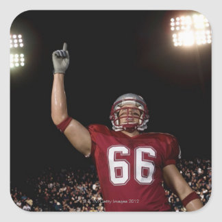 Football player holding up index finger square sticker