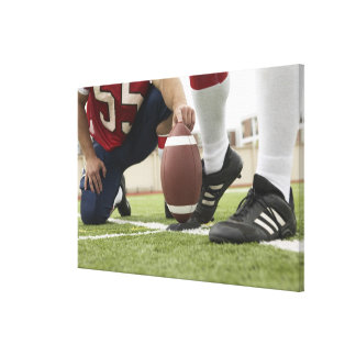 Football Player Kicking Football Canvas Print