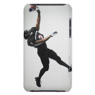 Football player leaping in mid air to catch ball iPod touch case