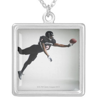 Football player leaping in mid air to catch ball silver plated necklace