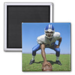 football player playing on a football field 2 inch square magnet