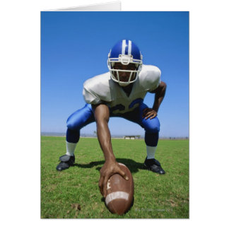 football player playing on a football field card