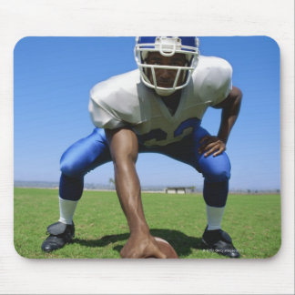 football player playing on a football field mouse pad